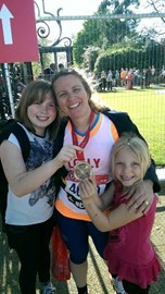 With my girls and my finishers medal. #Feeling proud