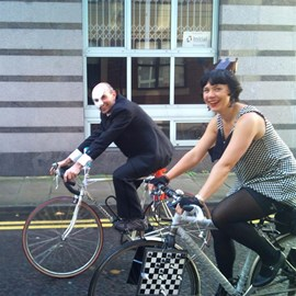 Huw and Fran courting on their bikes