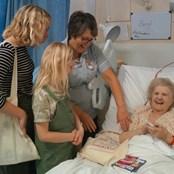 Patients enjoy a visit from local school children.
