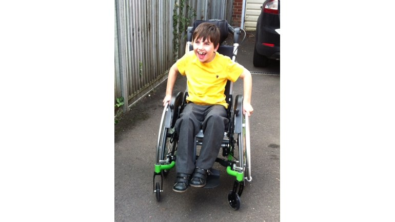 Daniel in his new wheelchair.. thank you!