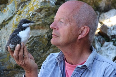 Tim Birkhead with Guillemot chick
