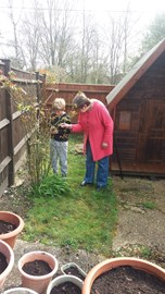 Mum teaching George about gardening