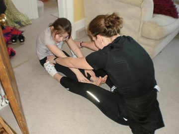 Stretching with Keira after 18 mile run