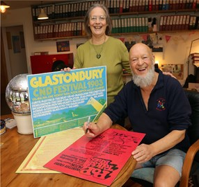 Fiona Case and Michael Eavis with signed posters
