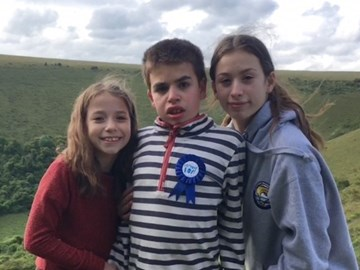 Daniel with his sisters on his 14th birthday
