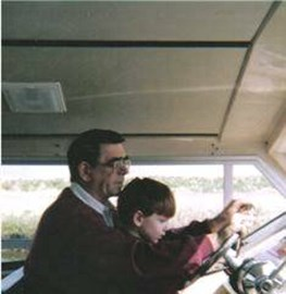 Me and my Grandad when I was 4, learning to drive a boat on the Norfolk Broads :)