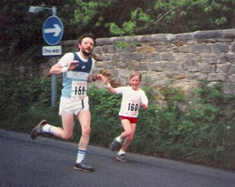 Me running my first fun run aged 10! With my Dad!