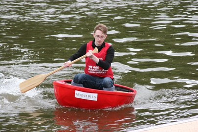Kit giving his all at the coracle race in 2012.