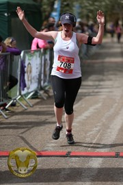 Crossing the finishing line at the Longhorn 10k