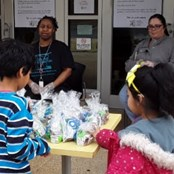 Kids picking up pre-packaged meals at a CALS branch.