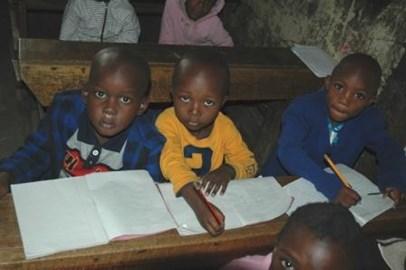 Primary children treasure their exercise book