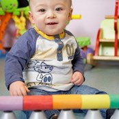 Axl playing with his toys in the play room at BRI