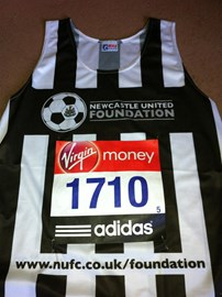 Aptly sponsored NUFC running vest.