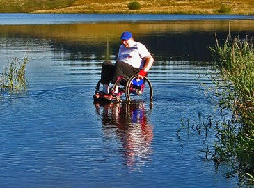 Paddling in my wheelchair at the Calvert Trust Kielder