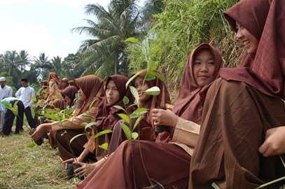 Students planting trees in Indonesia
