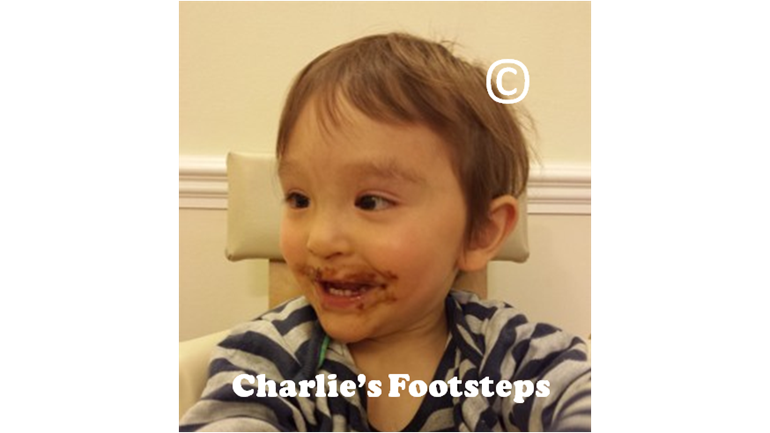 Charlie having his first taste of chocolate
