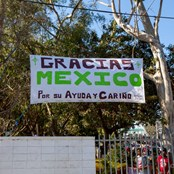 The migrants had raised a large banner thanking the Mexican people for their help and kindness