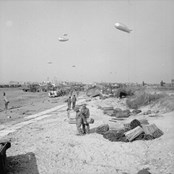 General view of Gold Beach, 7 June 1944. LCT 7074 can be seen beached just right of centre.
