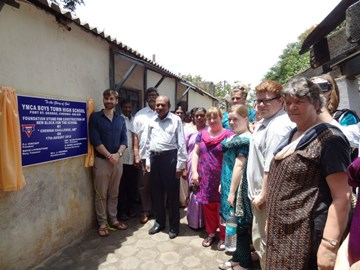 lasying the foundation stone of the new building at YMCA Fort school