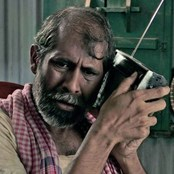 A man in Bangladesh listens to a portable radio. Credit: BBC Media Action