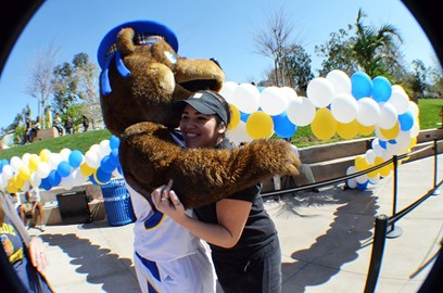 Back at UCR giving Scotty our mascot a hug