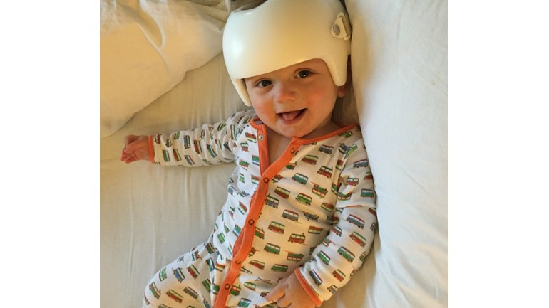 Happy little boy with his helmet!